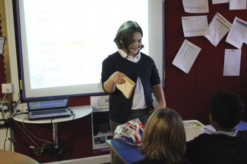 Faith having a go at being a sandwich-bot taking instructions from another child
